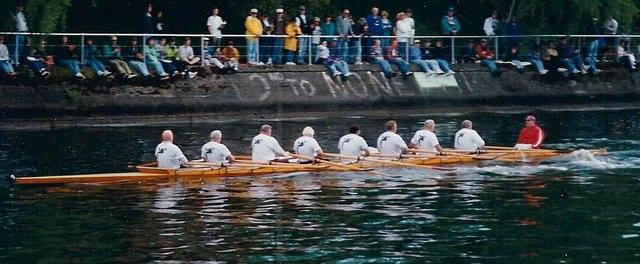 The Ancient Mariners rowing the Kathy Whitman through the Montlake Cut, winning their Opening Day race