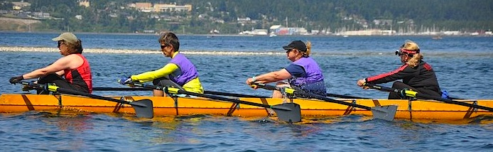 Peggy Myre (stroke), Sally Aerts, Peggy Johnson and Sally Giesler (cox) beating the other quads in their class (Photo courtesy of Mike Lampi, Sound Rowers)