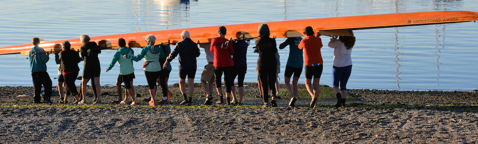 2014 The heavyweight Quinault gets an all-Rats escort to the water during the Wooden Boat Festival regatta.