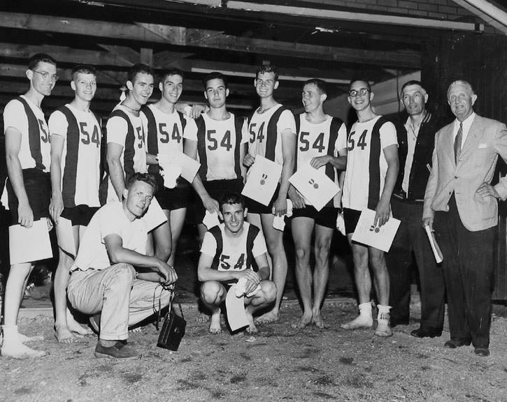 UW Freshmen after the 1951 IRA win at Marietta, Ohio. (from left to right) Jim Howay, Roland Camfield, William John, Ivar Birkeland, Gordon Hardy, Ted Frost, Keith Riely, Guy Harper, Al Ulbrickson and John Lyon Collyer who was responsible for the medals. Guy Harper scrapbook.